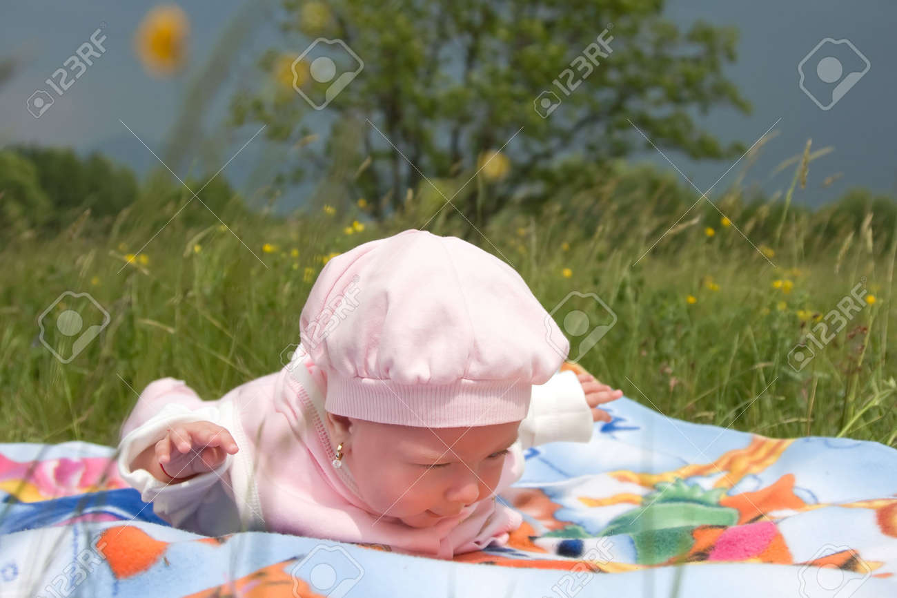 Cute baby girl enjoying a day in nature Stock Photo - 4888419