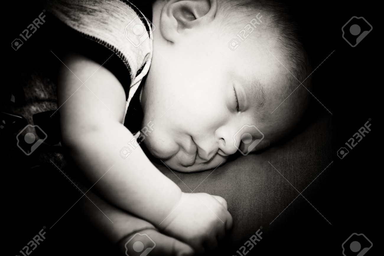 New born baby boy sleeping peacefully, black and white photograph. Stock Photo - 7302729