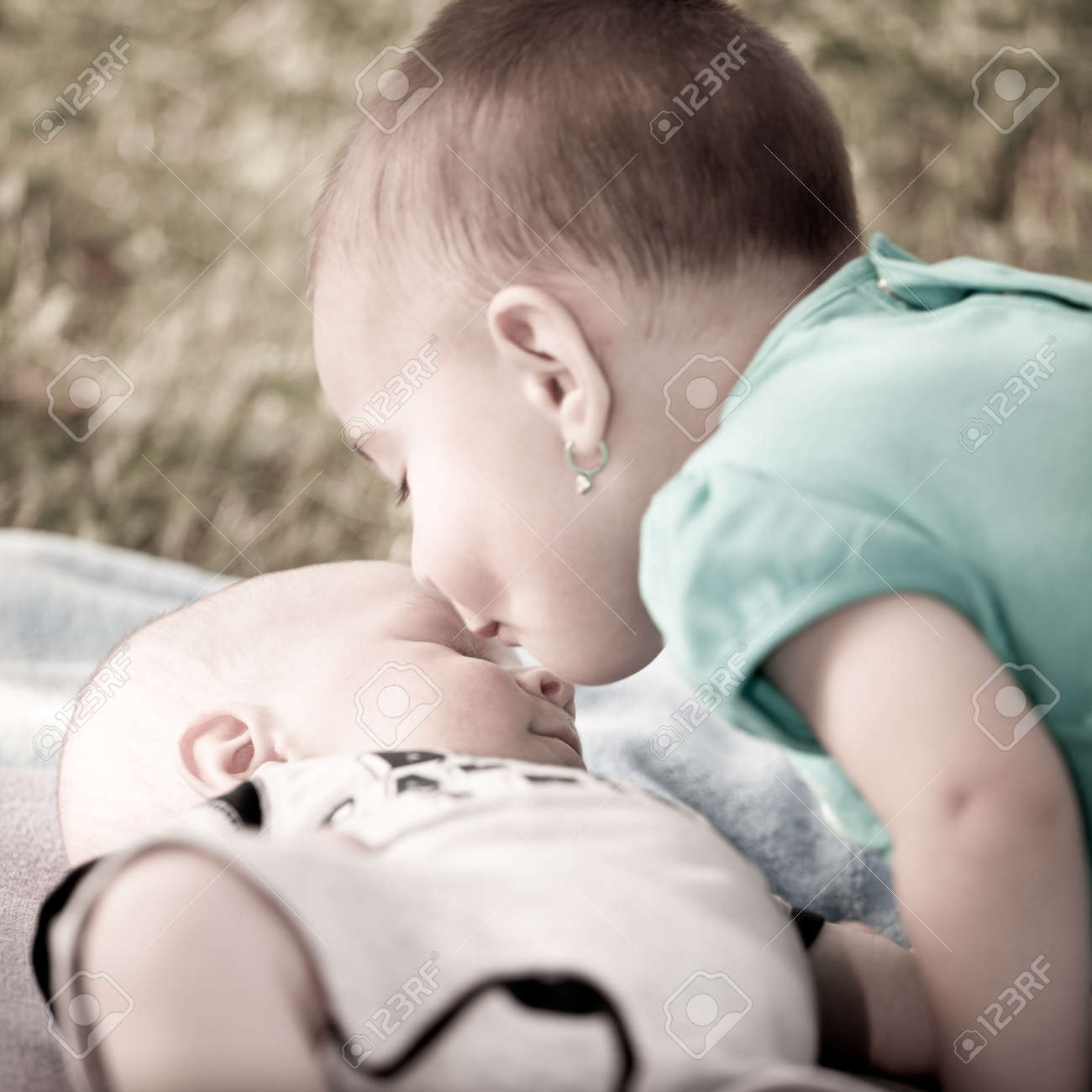 Bay girl giving a kiss to her new born baby brother Stock Photo - 7302663