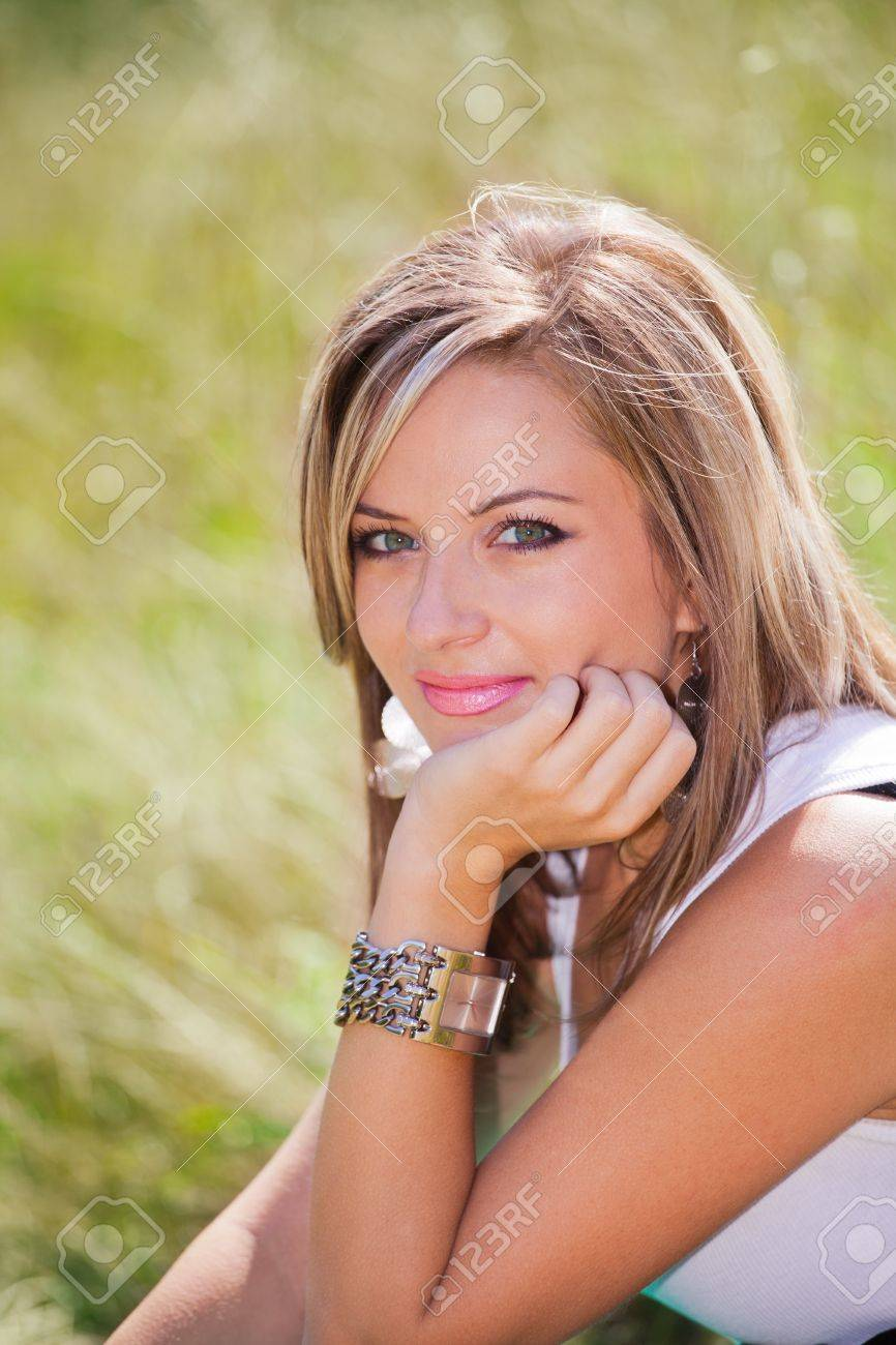 Young woman in her twenties, in the park in summer. Stock Photo - 10640749