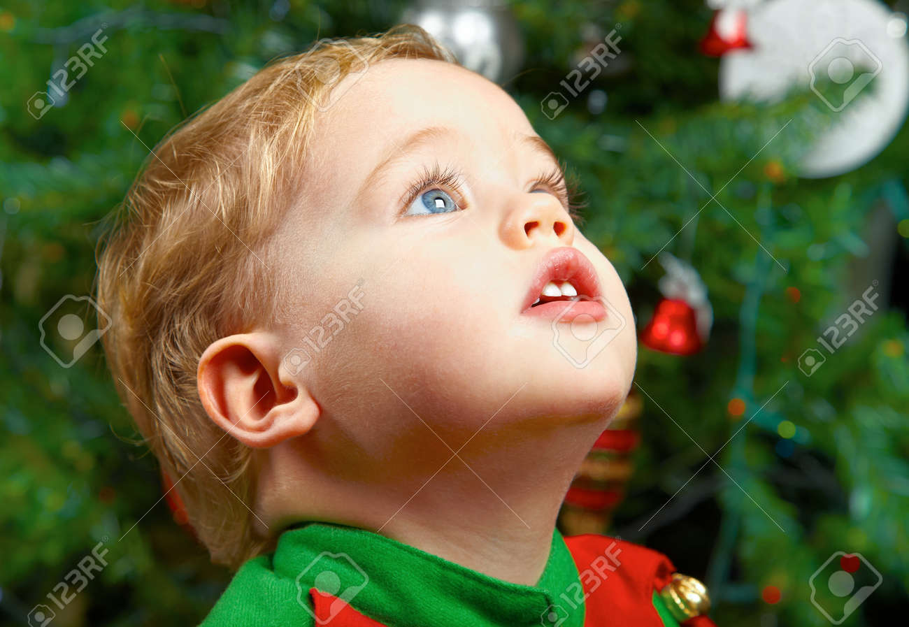 Cute 1 year old baby boy at the Chriistmas tree. Stock Photo - 11808143
