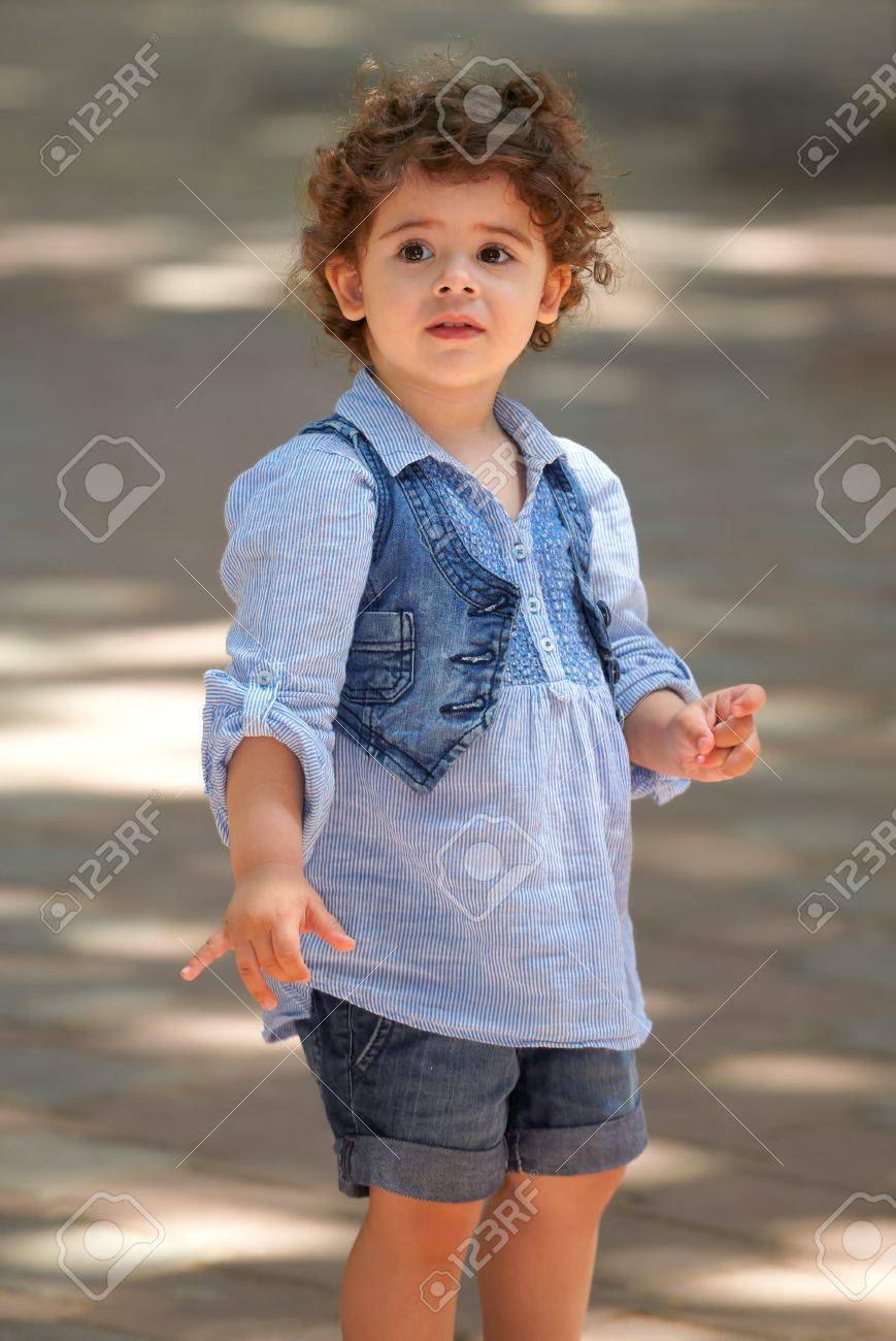 Portrait of happy two year old little girl outdoor. Stock Photo - 14225801