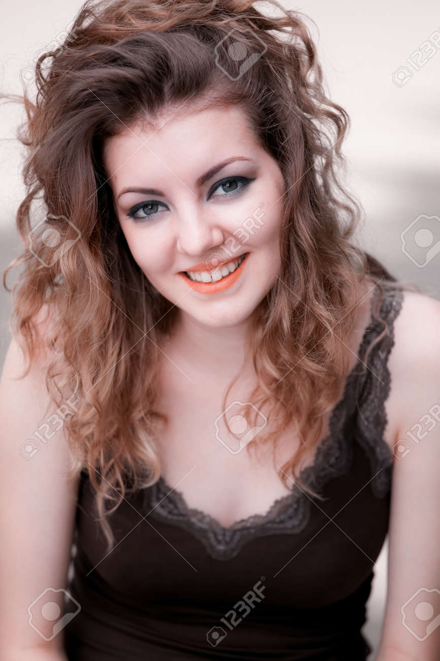 Portrait of young caucasian woman outdoor, warm light. Stock Photo - 17096284