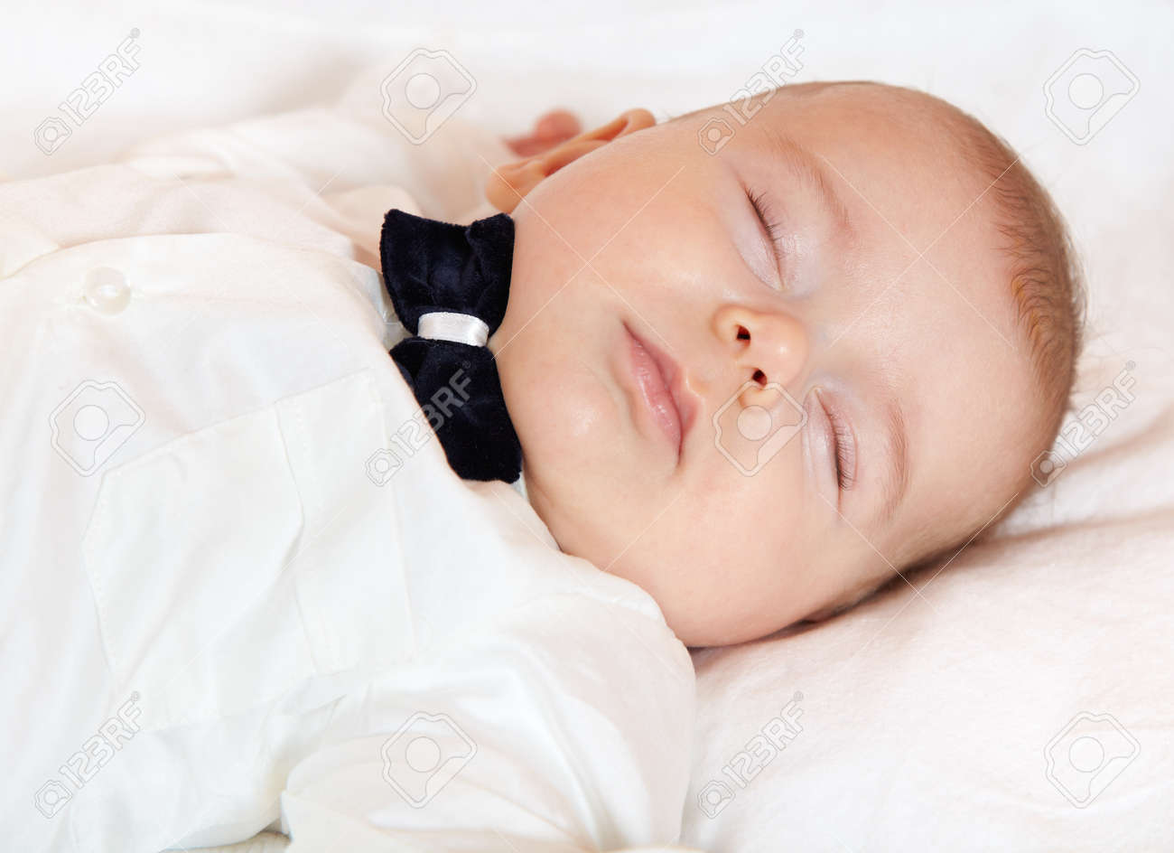 Baby boy dressed for party sleeping peacefully. Stock Photo - 17501237