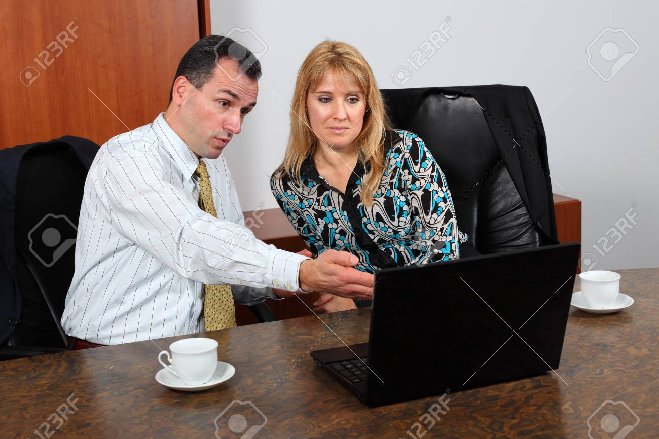 Portrait of a handsome businessman interacting with his associate. Stock Photo - 8965291