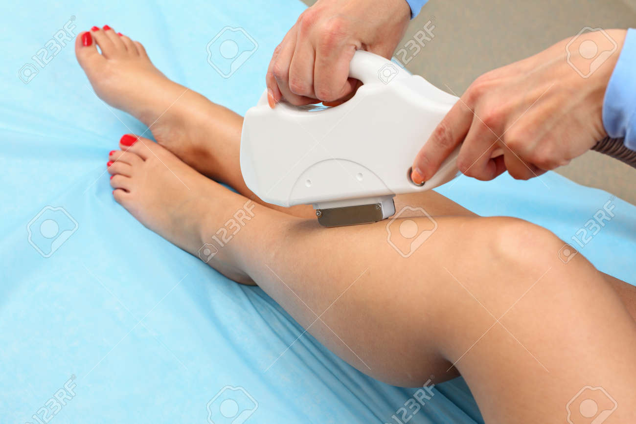 Laser hair removal on ladies legs. Intentional shallow depth of field. Stock Photo - 9344405
