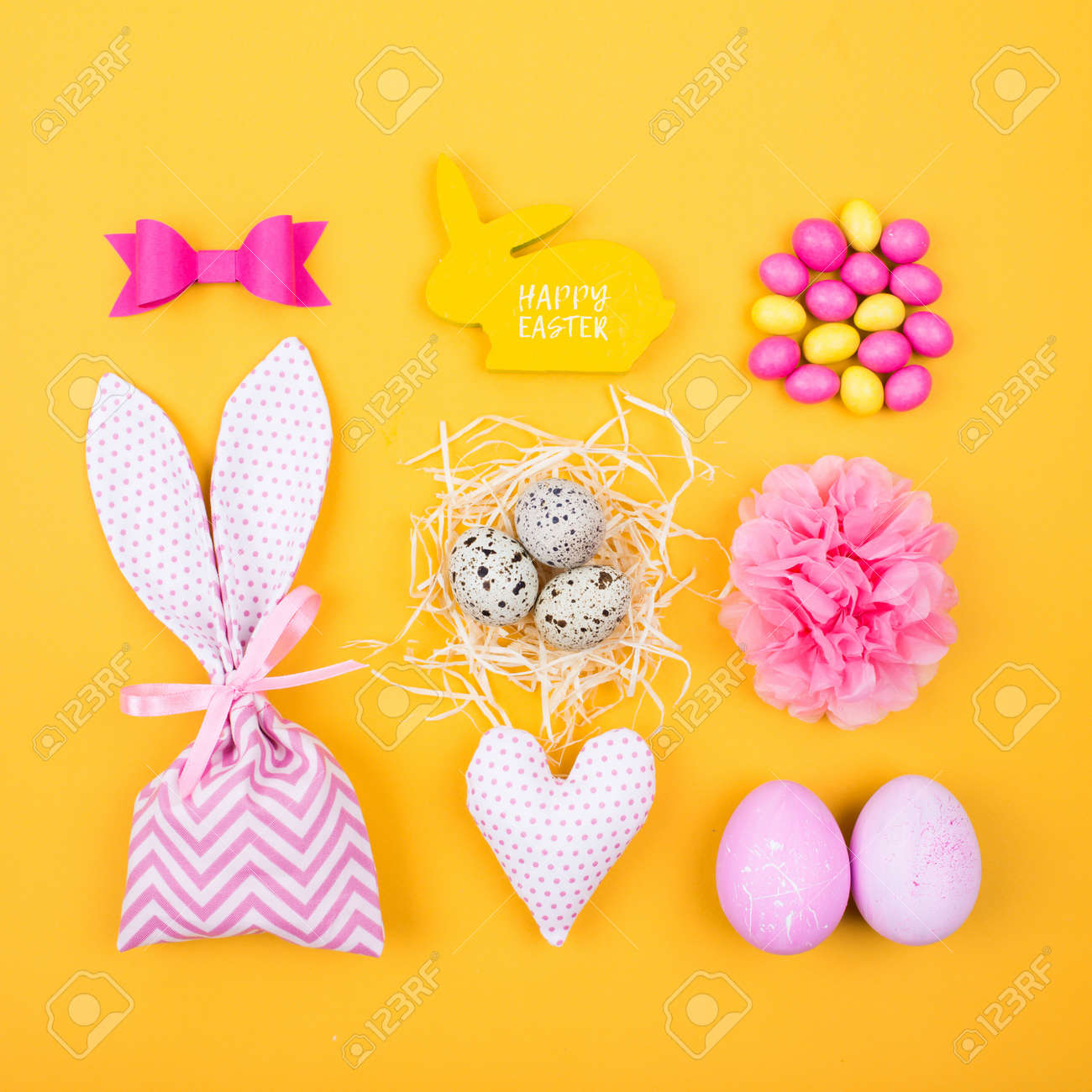 flat lay stylish set pink and yellow easter eggs fabric bunny
