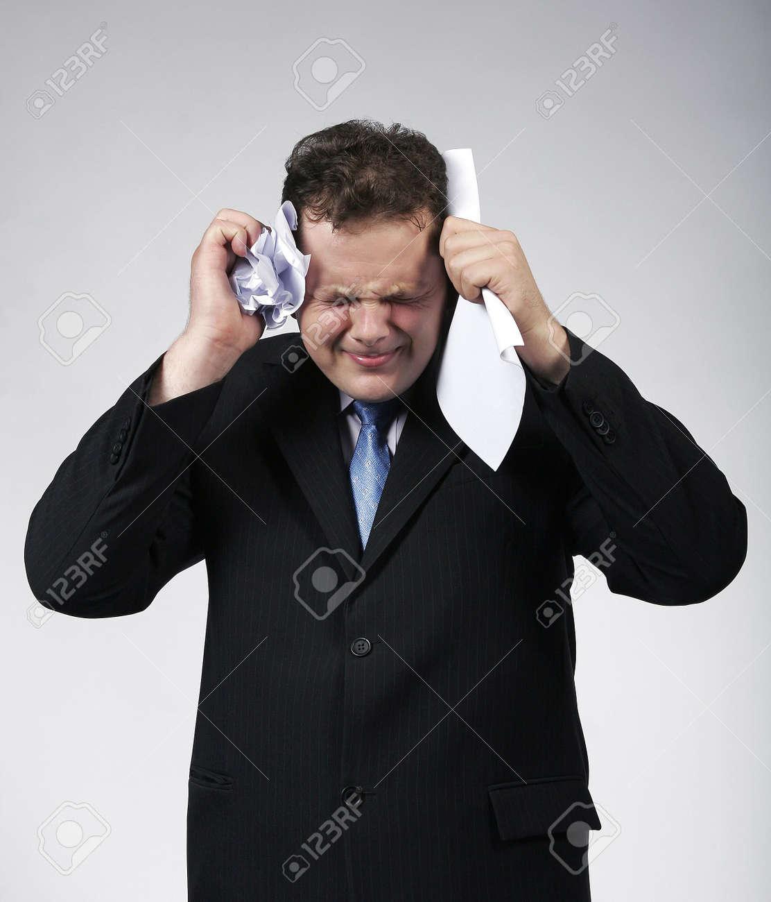Depressed businessman closing his eyes ready to cry. Studio shot Stock Photo - 6735844