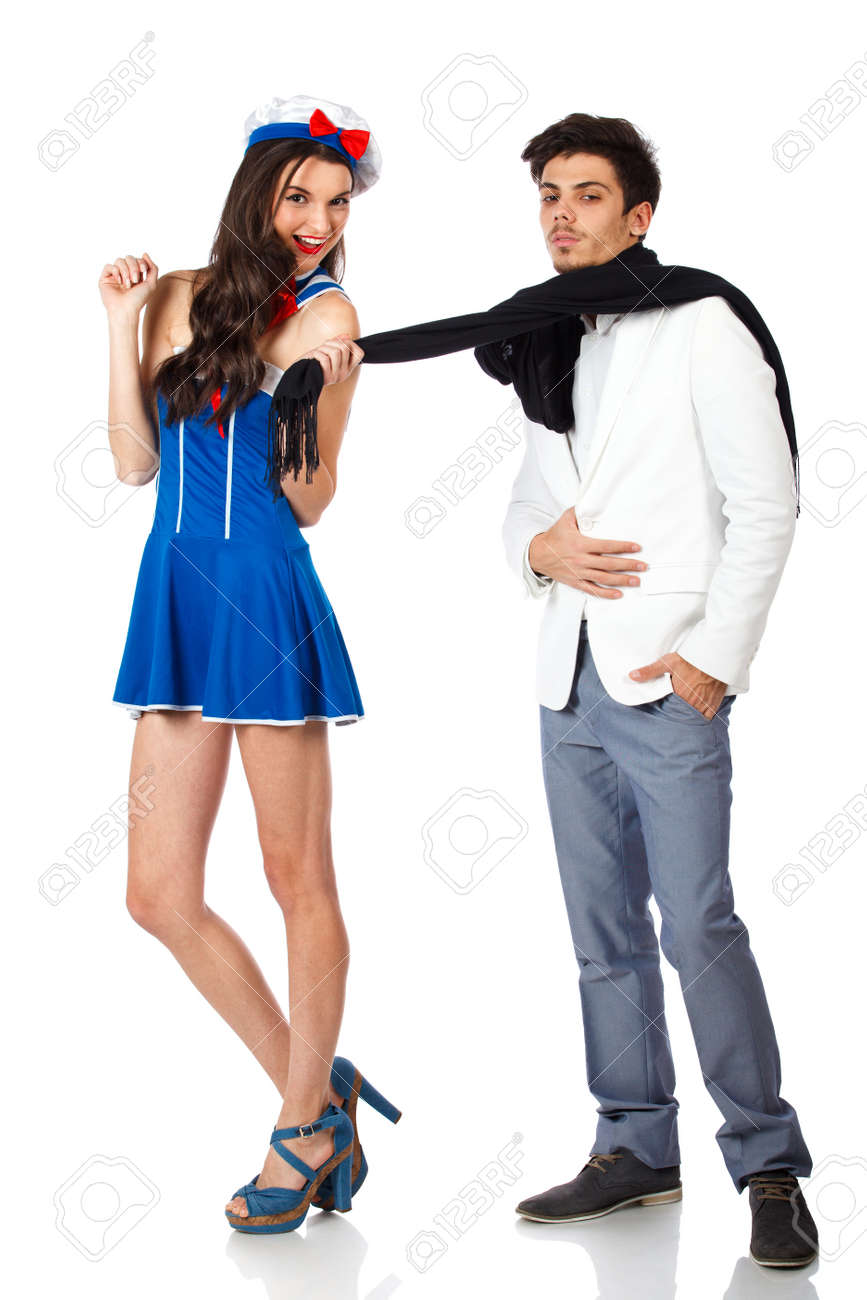 Full body shot of sexy young woman wearing sailor uniform seducing confident young man.Isolated on white background. High resolution studio image Stock Photo - 12388976