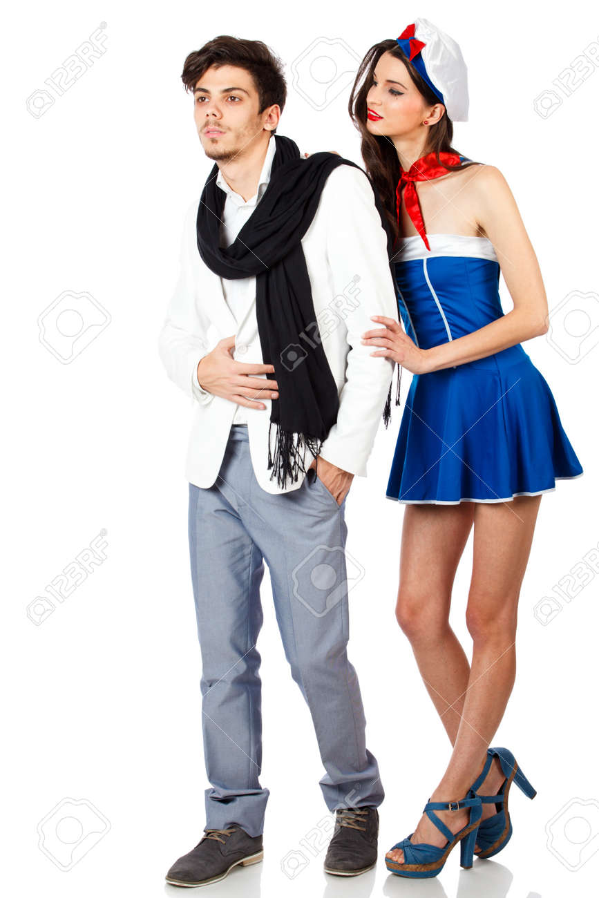 Beautiful young couple. Sexy woman in sailor uniform seducing elegant man. Isolated on white background. High resolution studio image Stock Photo - 12389030