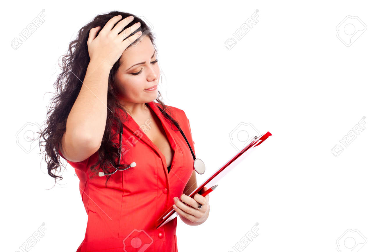 Bad news for a  professional young nurse or medical woman  doctor with big breasts, wearing tangerine tango orange uniform dress ,with clipboard. Isolated on white background with text space. High resolution studio image. Stock Photo - 12631808