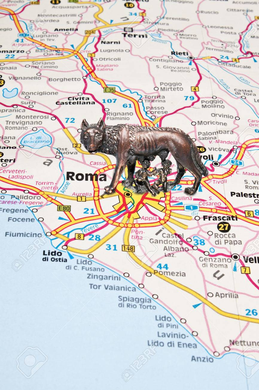 Figurine Of The Roman She Wolf On An Italy Map Near Rome Stock Photo