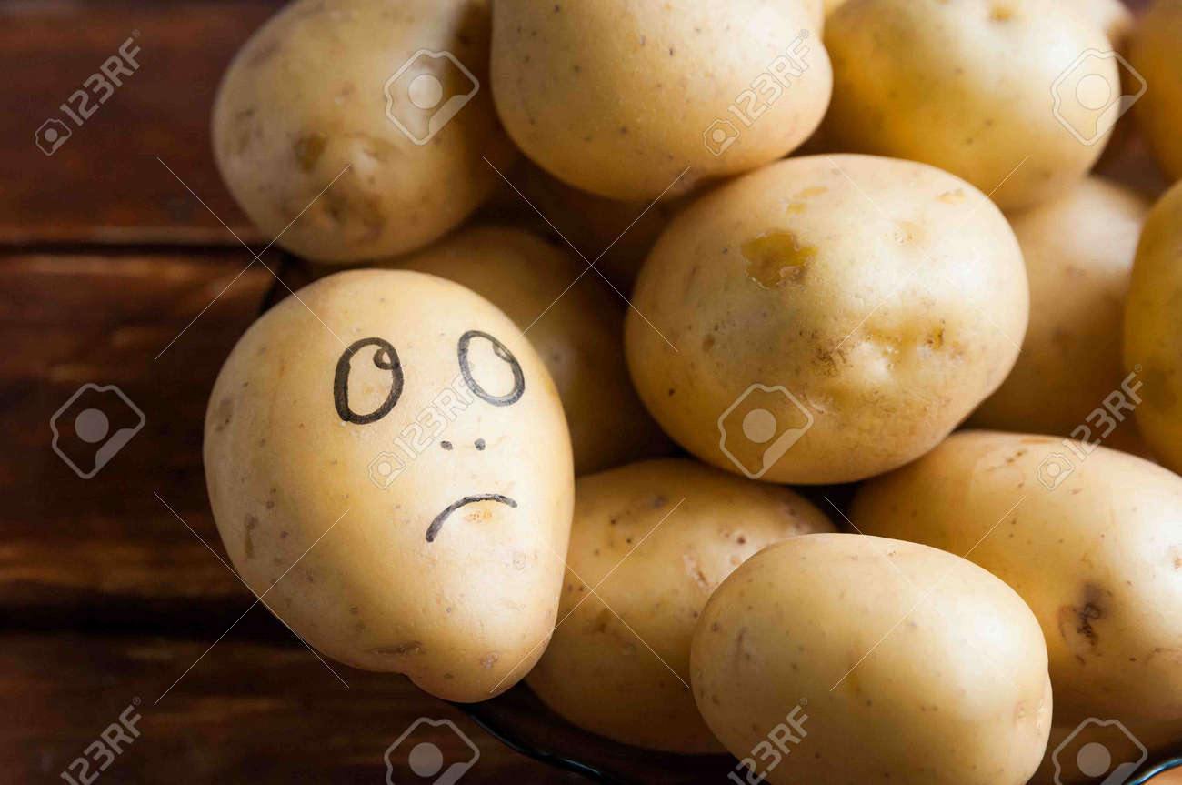 Eyes Painted Potato Looking At Fruit Stock Photo Picture And