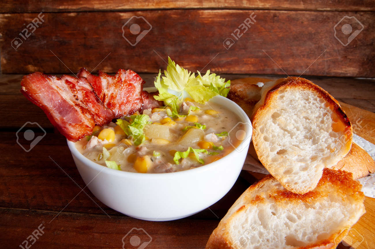 Corn chowder soup with bacon. Brown wooden background. Close-up view - 166442919