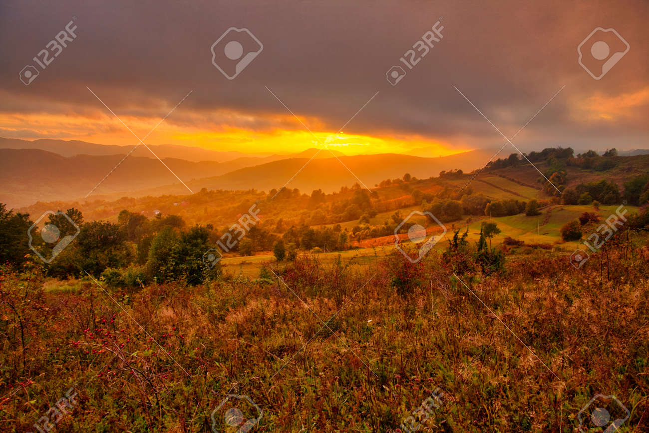 Magestic sunset in the carpatian mountains. Natural autumn landscape. - 128772823