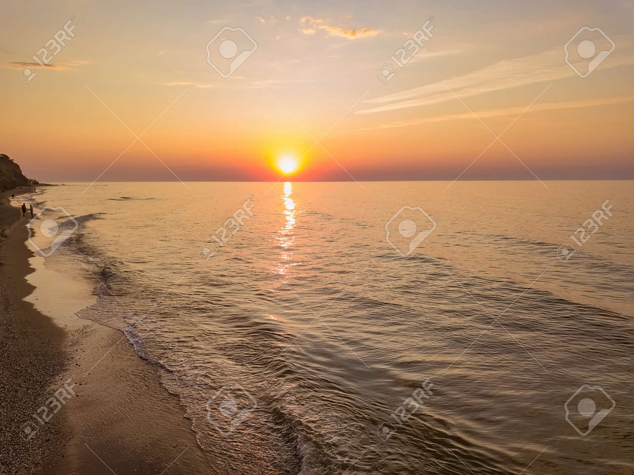 Aerial panoramic view of sunrise over ssea. Nothing but sky, clouds and water. Beautiful serene scene - 140898694