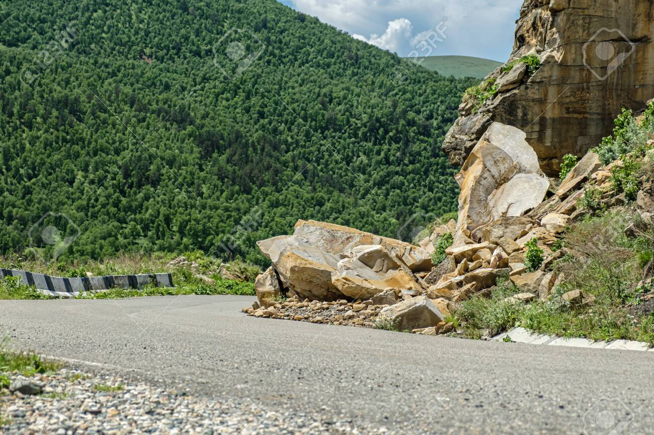 Rockfall on the road in the mountains. - 141669683