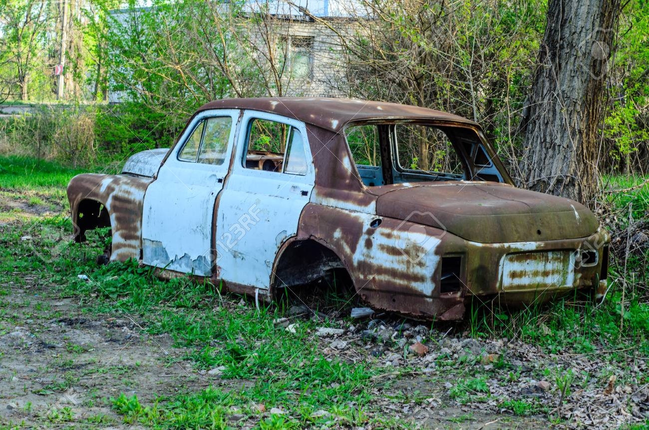 Old Rusty Car Body On A Ground Stock Photo, Picture And Royalty Free ...