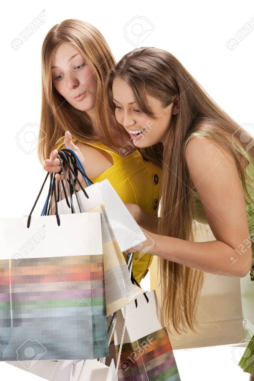Shopping. Two beautiful girl with bag isolated on white backgrou Stock Photo - 8937473