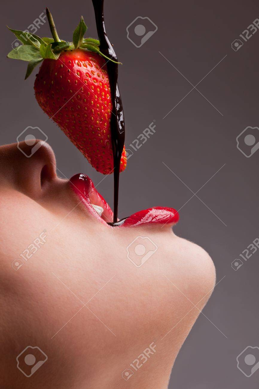 girl eating strawberry with chocolate sauc Stock Photo - 8950945