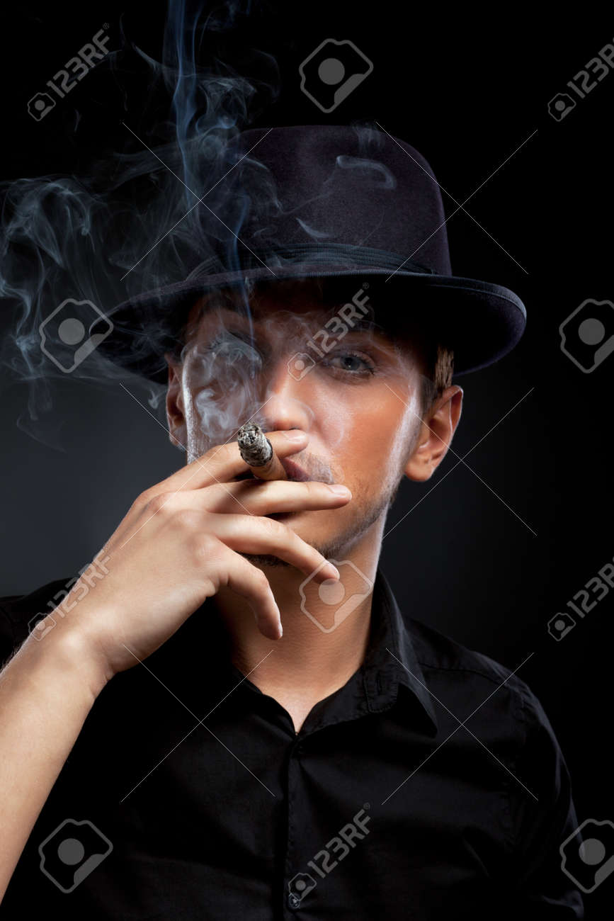 Gangster look. Man with hat and cigar. Stock Photo - 9619934