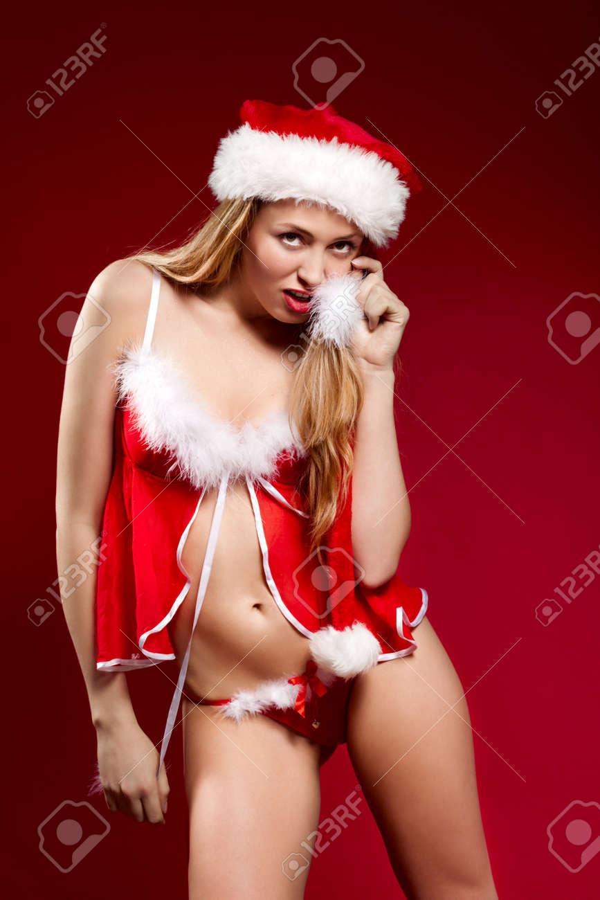 c75f099b409 Sexy santa helper girl on red background