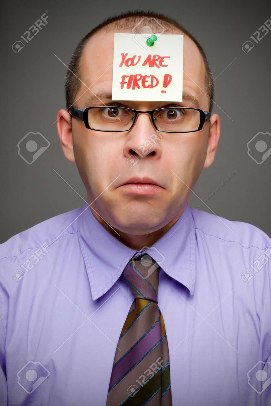 Adult businessman fired from work by a sticker note Stock Photo - 6474905