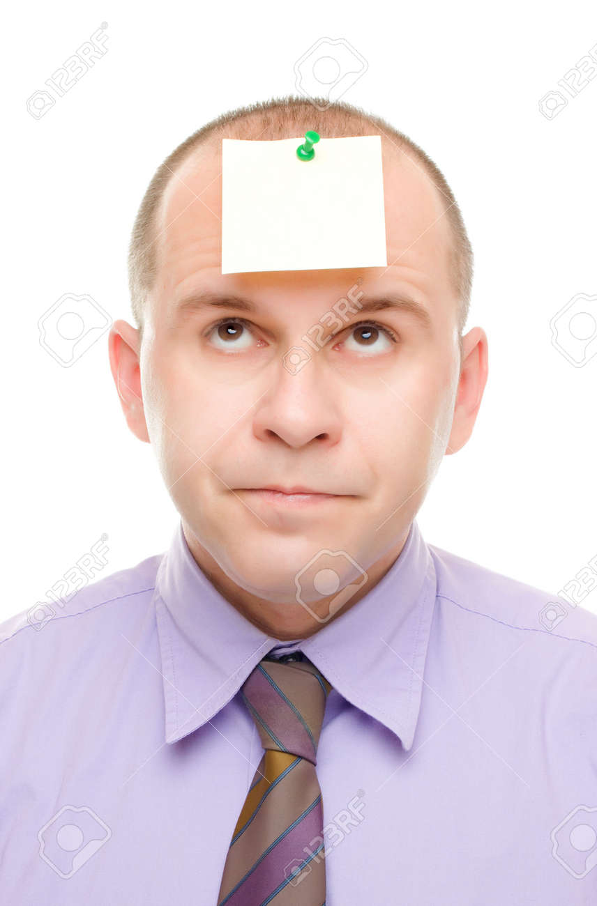 Businessman with a note pinned on his head isolated on white Stock Photo - 6474906