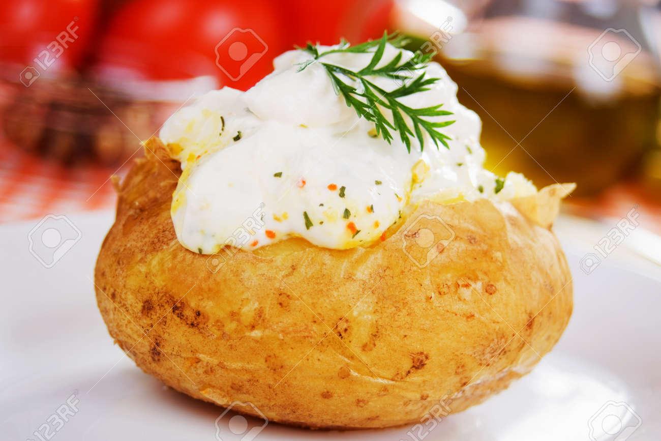 Baked potato with sour cream sauce, selective focus Stock Photo - 7730104