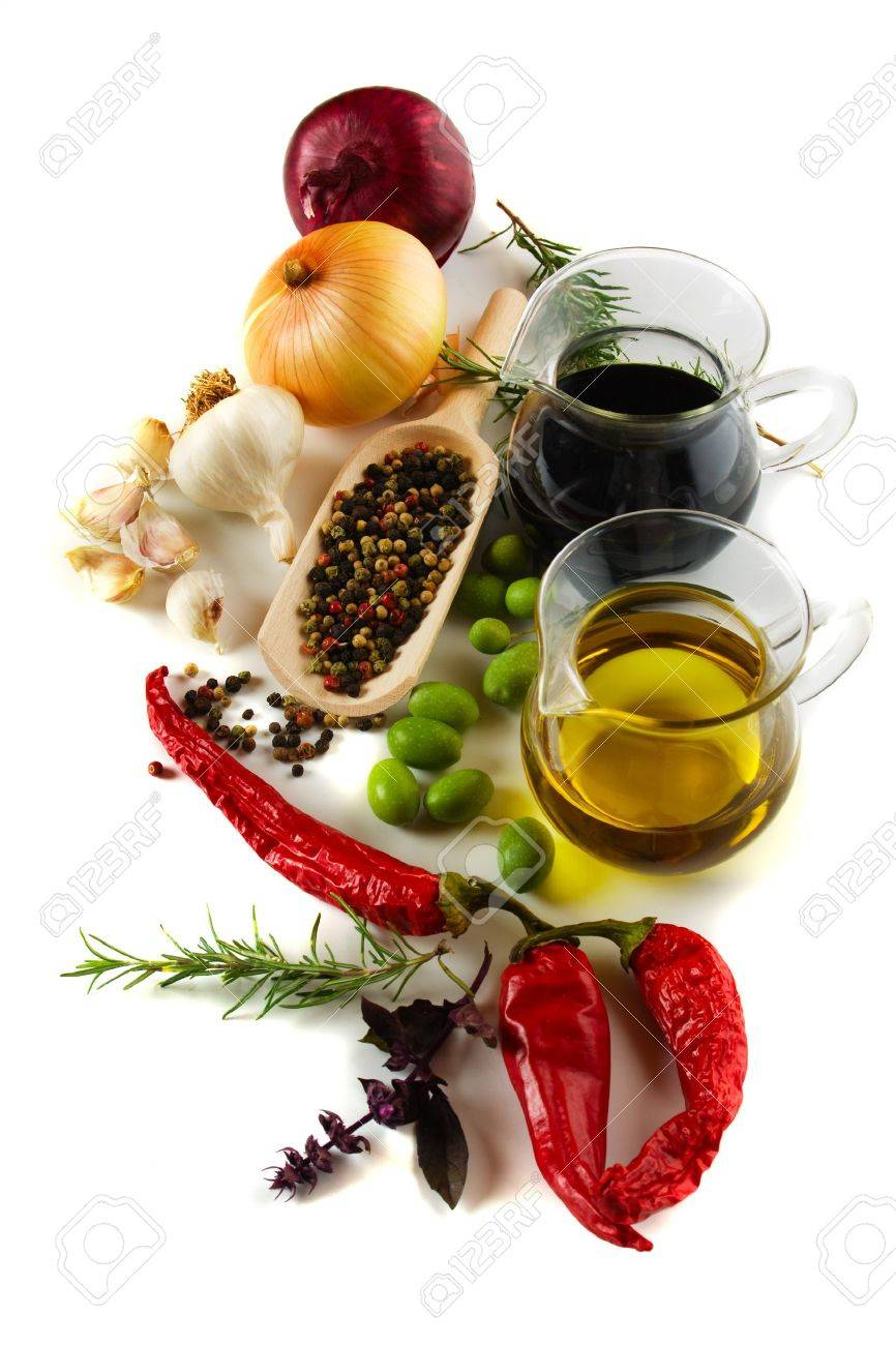 Olive oil and balsamic vinegar with mediterranean spices isolated on white Stock Photo - 8294304
