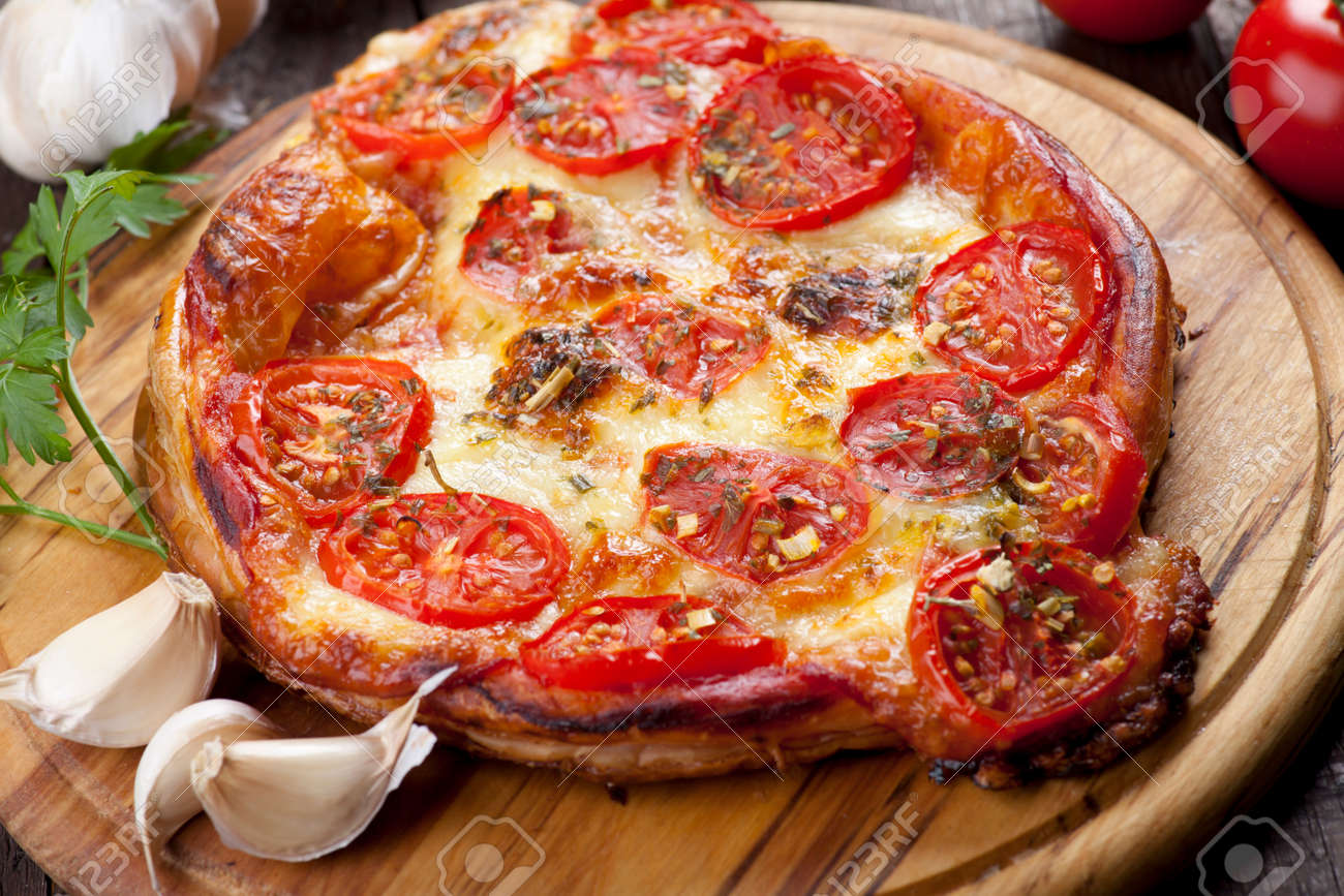 Puff pastry pizza margherita with cheese and tomato - 50328542
