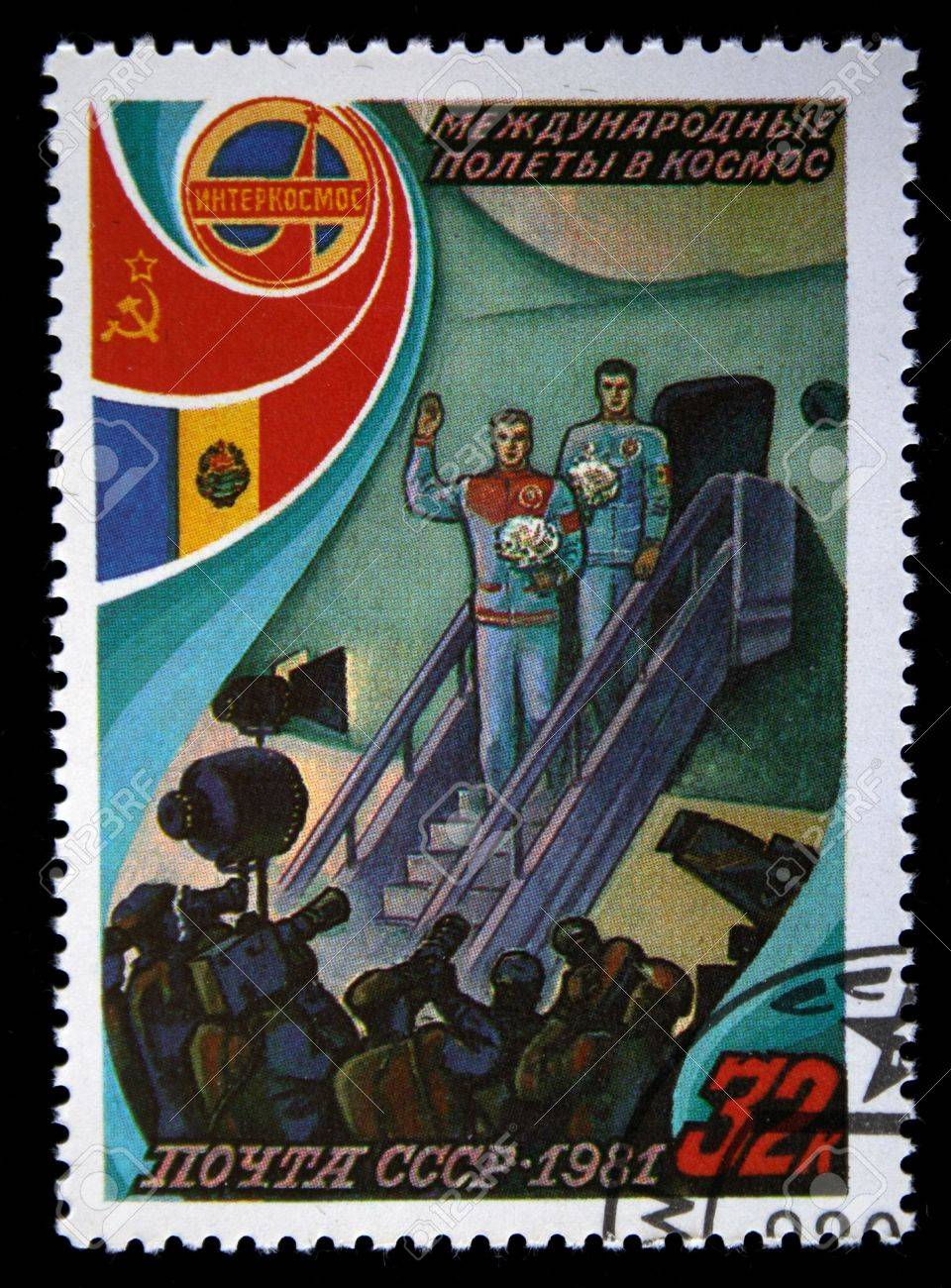 A stamp printed in the USSR shows cosmonauts, stamp from series honoring international cosmic flights and devoted coopertion of USSR and Romania, circa 1981. Stock Photo - 5632168
