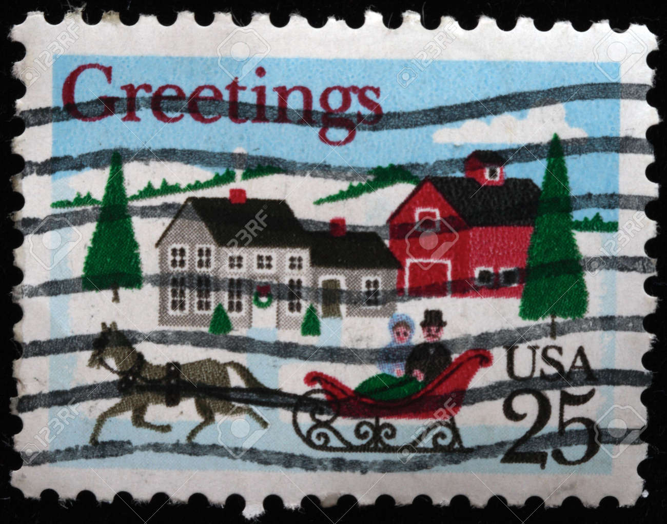 UNITED STATES OF AMERICA - CIRCA 1980s: A greeting Christmas stamp printed in the USA shows stocking with gifts, circa 1980s Stock Photo - 7434455