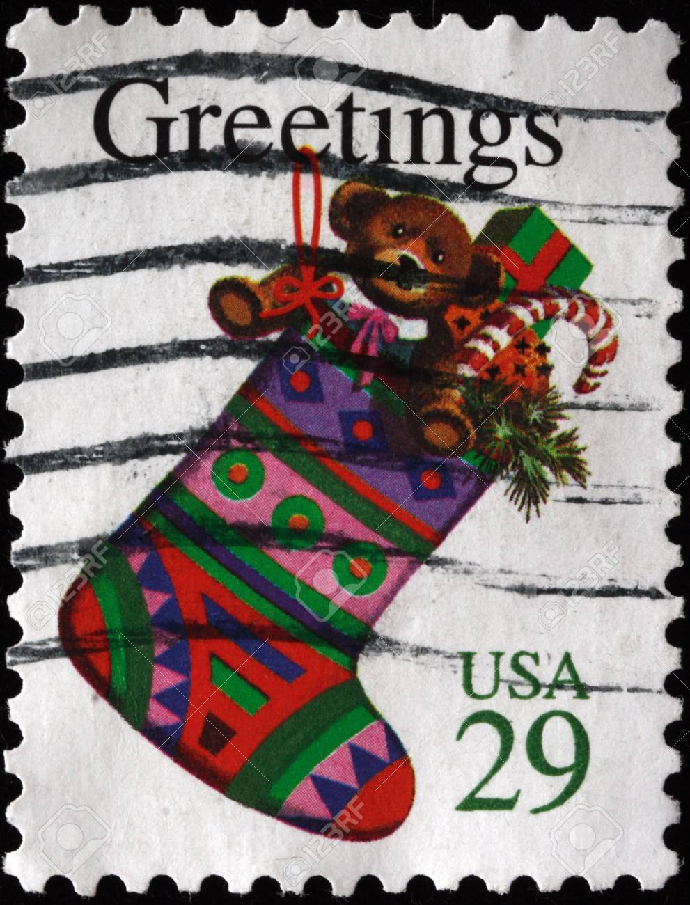 A greeting Christmas stamp printed in the USA shows stocking with gifts Stock Photo - 7448609