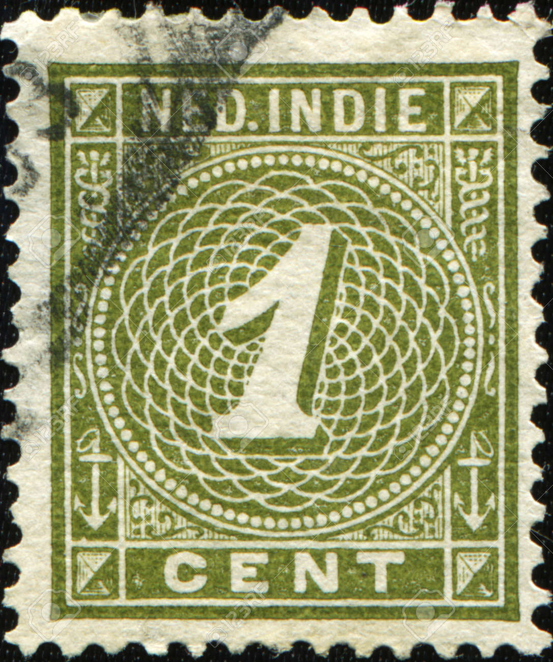 DUTCH EAST INDIES - CIRCA 1902: A  stamp printed in Dutch East Indies (Nederland Indie)  of numeral type shows Stock Photo - 8878499