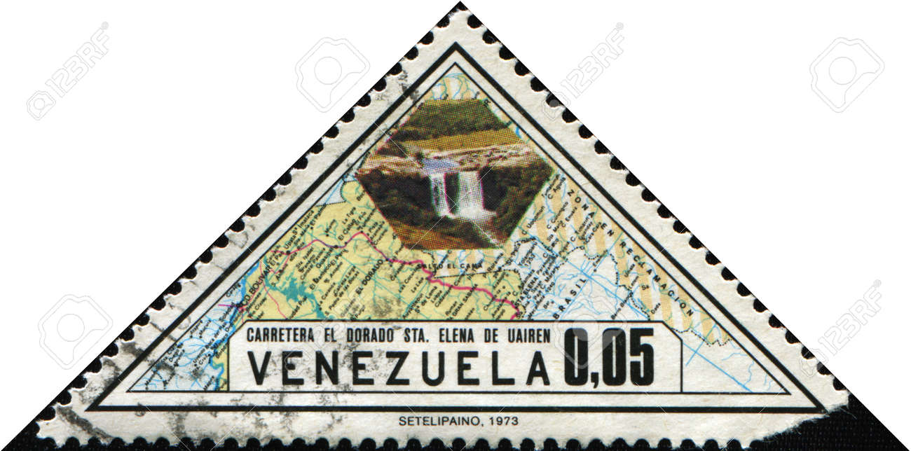 VENEZUELA - CIRCA 1973: A stamp printed in Venezuela honoring Completion of Golden Highway shows Map and waterfall, circa 1973 Stock Photo - 9528415