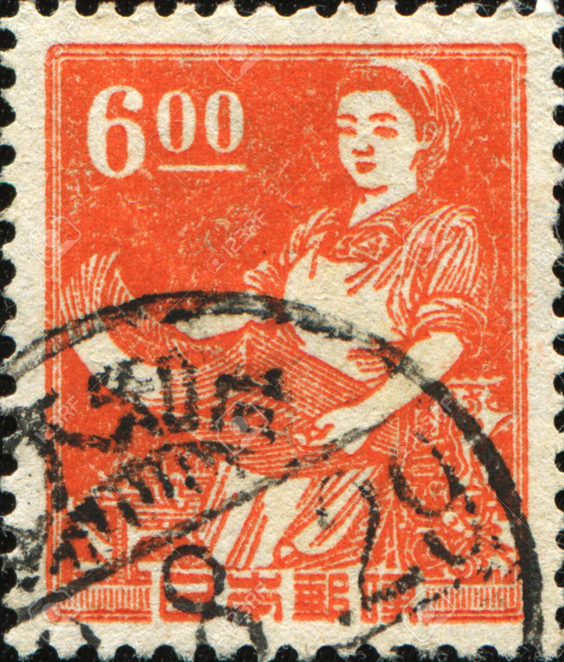 JAPAN - CIRCA 1949: A stamp printer in Japan shows girl printer, circa 1949 Stock Photo - 10491322