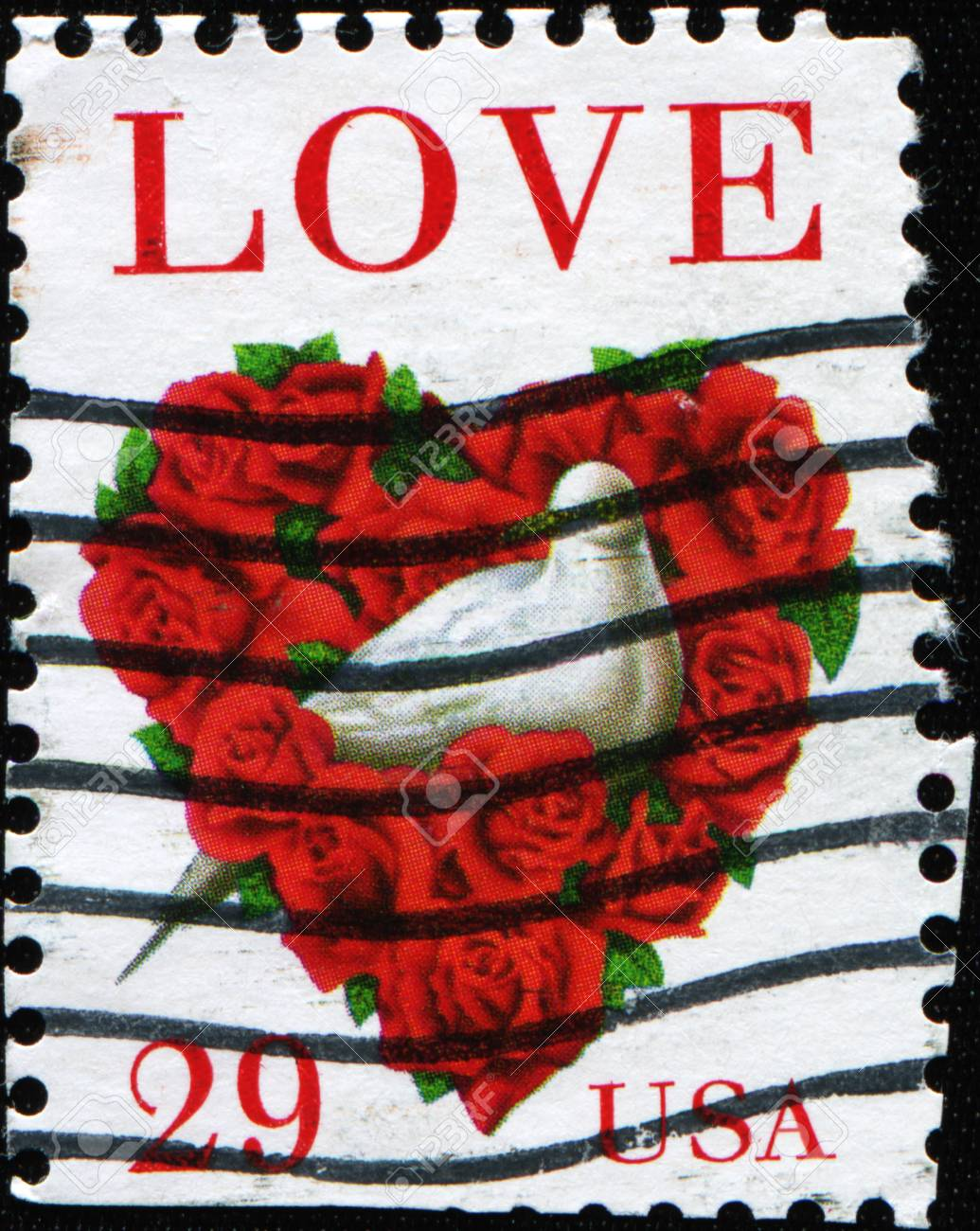 UNITED STATES OF AMERICA - CIRCA 1994: A stamp printed in the USA shows dove and a love heart made of roses, circa 1994 Stock Photo - 11574013