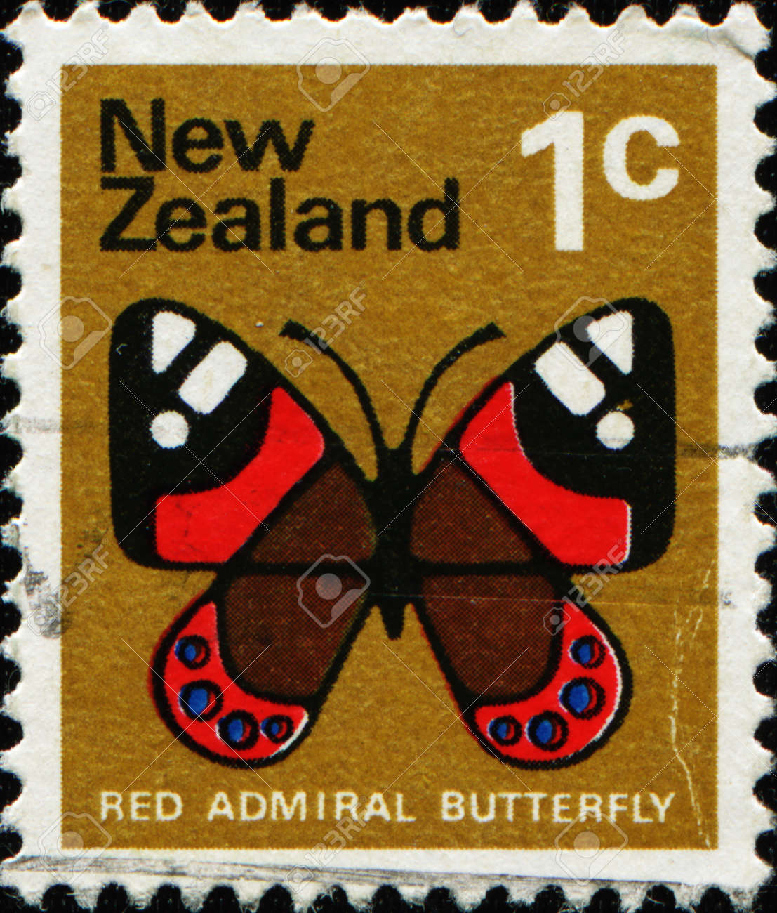 NEW ZEALAND - CIRCA 1970: A stamp printed in New Zealand shows image of a red admiral butterfly, series, circa 1970 Stock Photo - 11574012
