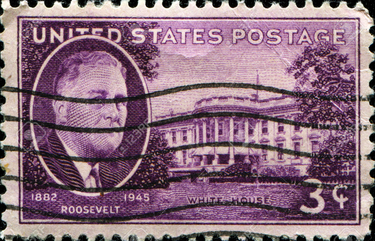USA - CIRCA 1945   Stamp in USA shows Franklin Delano Roosevelt 32nd President of the United States and White House, circa 1945 Stock Photo - 14175148