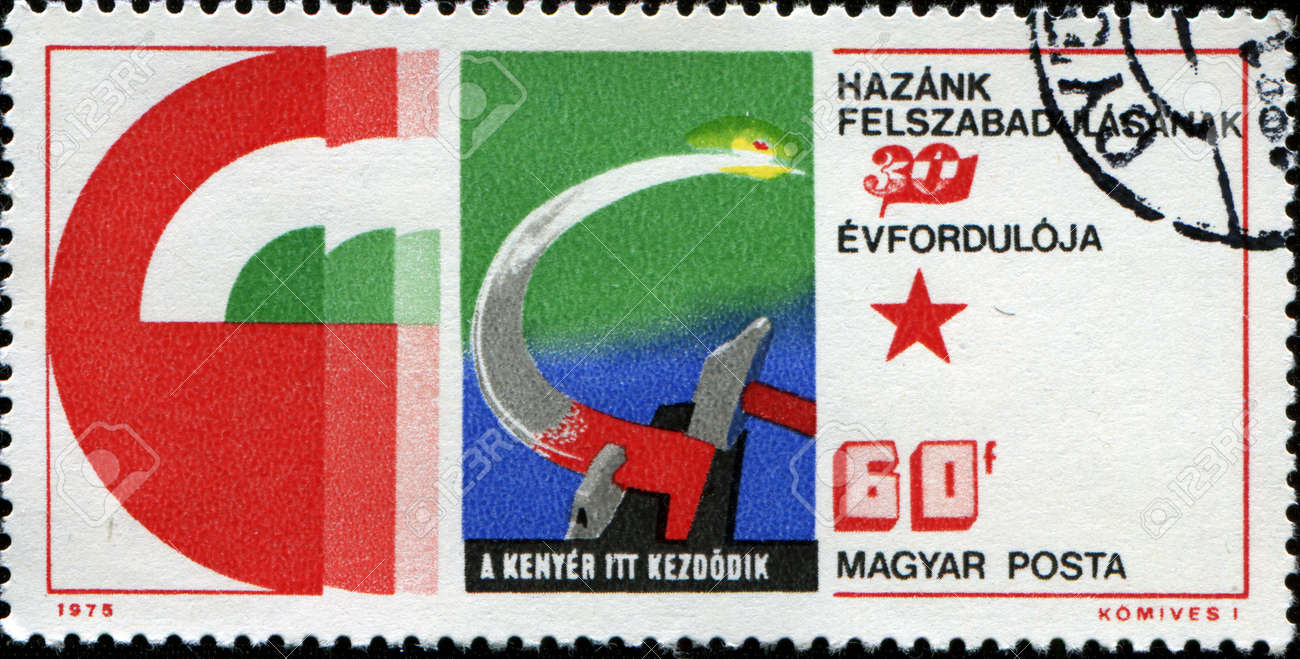HUNGARY - CIRCA 1975  A stamp printed in  Hungary honoring 30th Anniversary of Liberation, shows Hammer and sickle representing agriculture , circa 1975  Stock Photo - 14520559