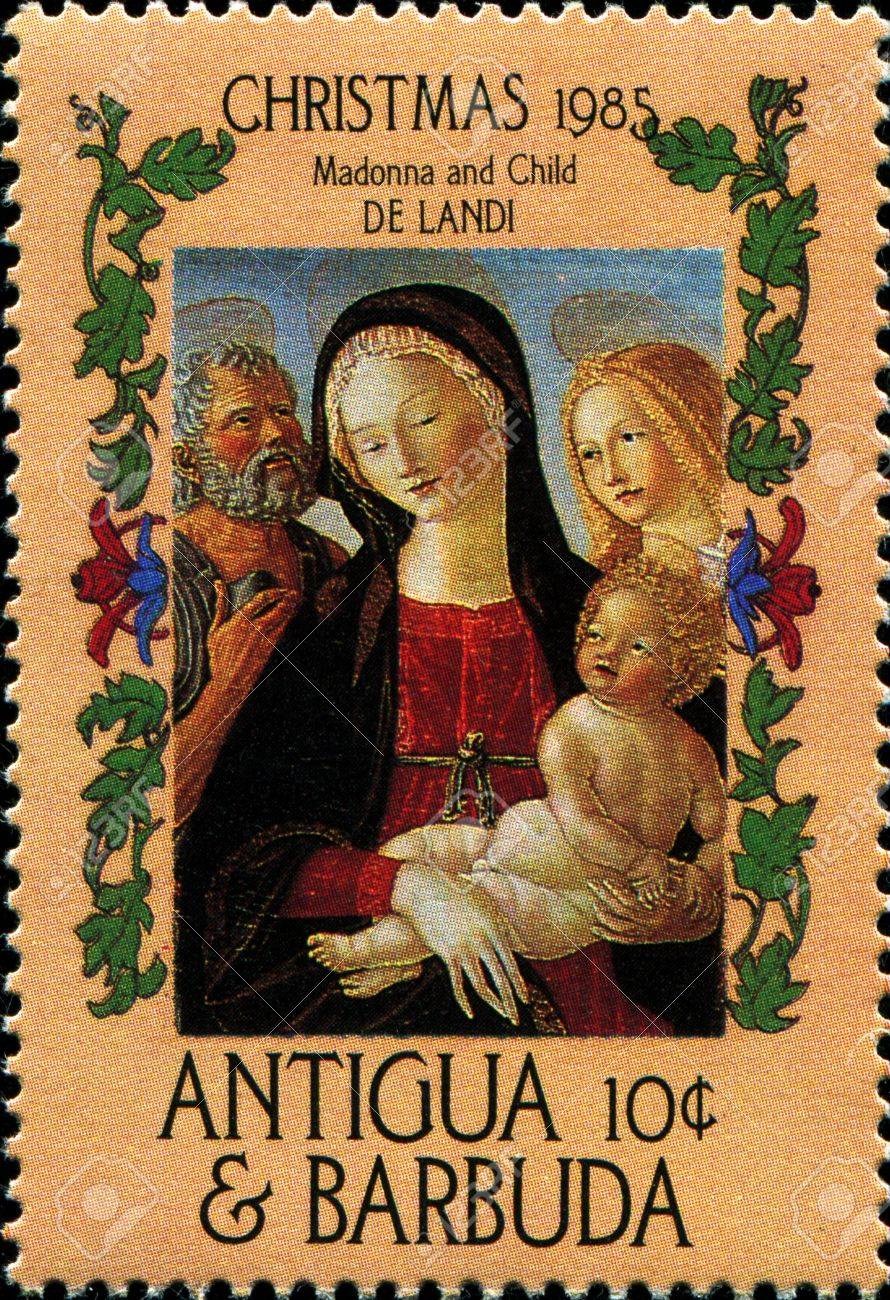 ANTIGUA   BARBUDA - CIRCA 1985  A postage stamp printed in Antigua and Barbuda showis Madonna and Child by De Landi, circa 1985 Stock Photo - 17269827