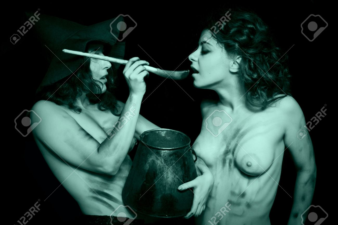 nude witches Stock Photo - Two dirty nude witches with kettle posing over dark