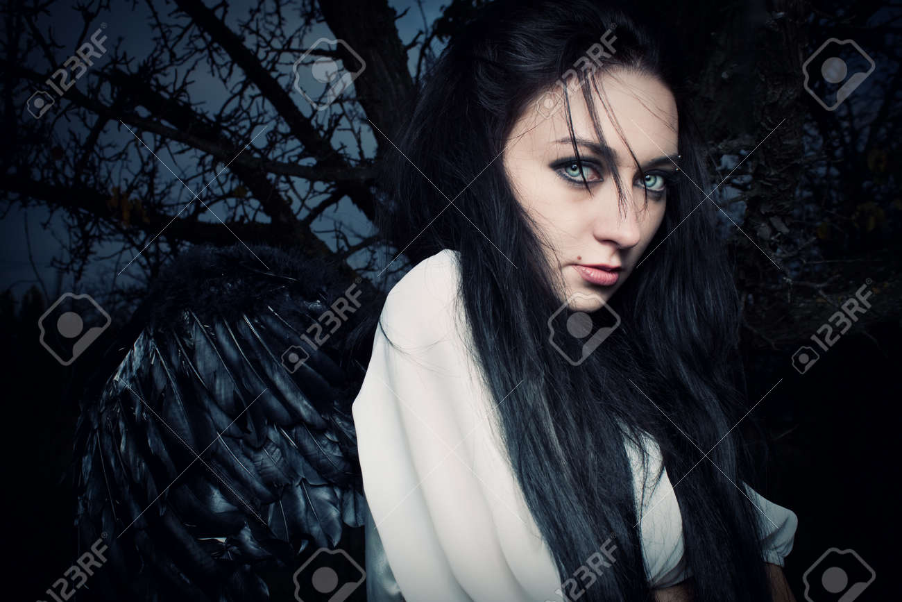 pretty dark-haired angel in the cold autumn forest Stock Photo - 12163268