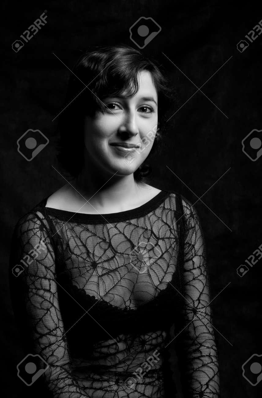pretty sexy girl posing over dark background Stock Photo - 12163164