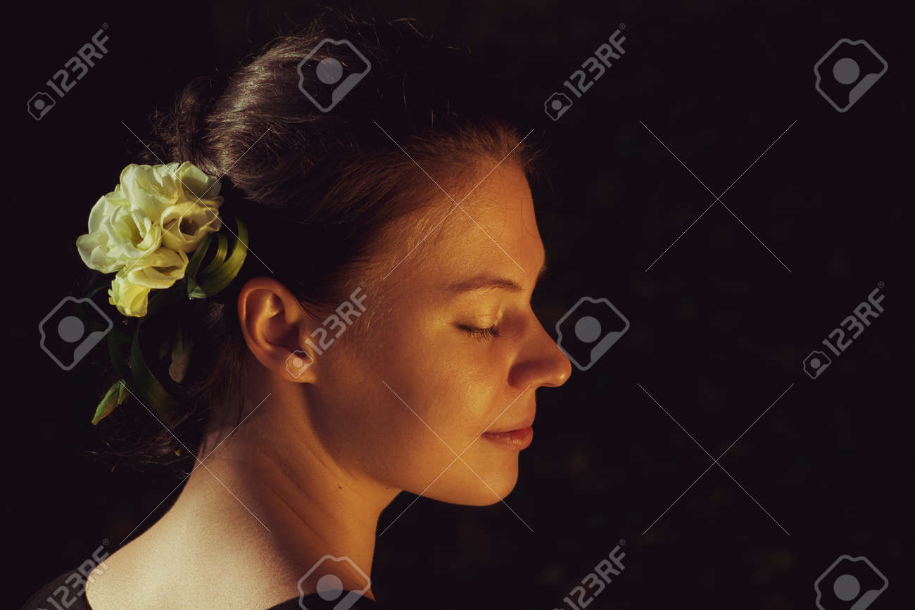 Pretty young woman with flowers in her hairs Stock Photo - 16084718