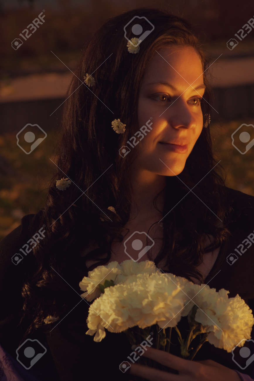 Portrait of pretty young girl with white flowers Stock Photo - 16119130