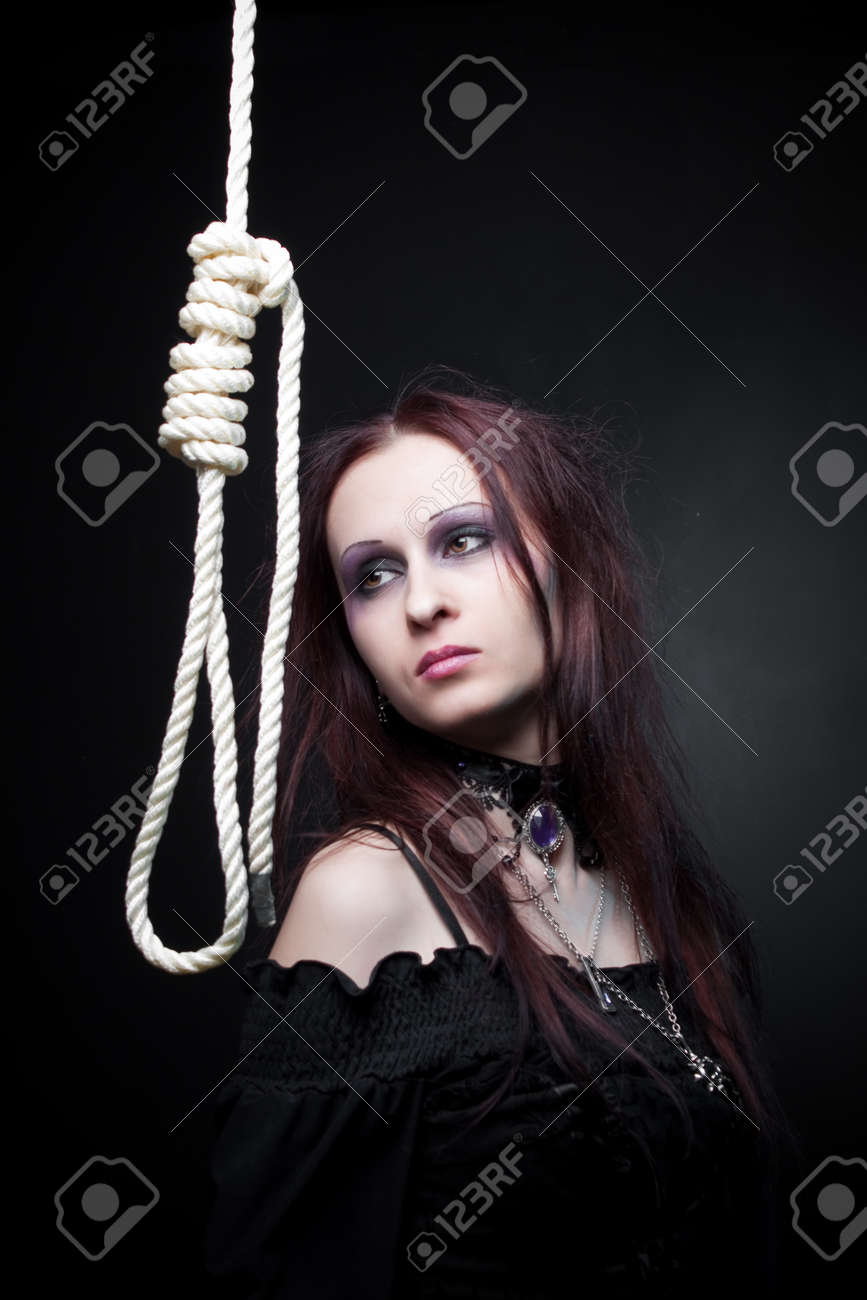 Pretty gothic girl posing with gallows over dark background Stock Photo - 16367145