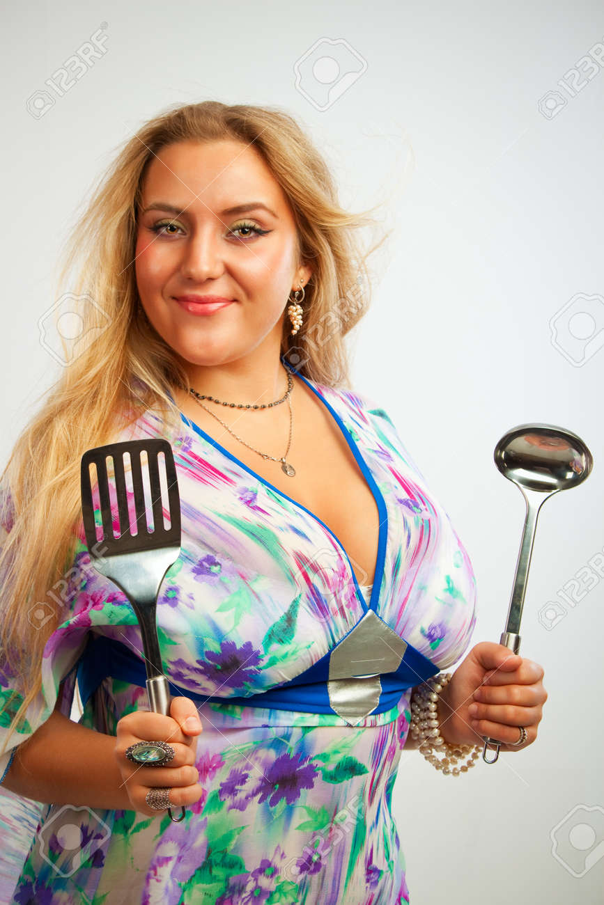 Seductive young woman with spatula and ladle over white background Stock Photo - 17605552