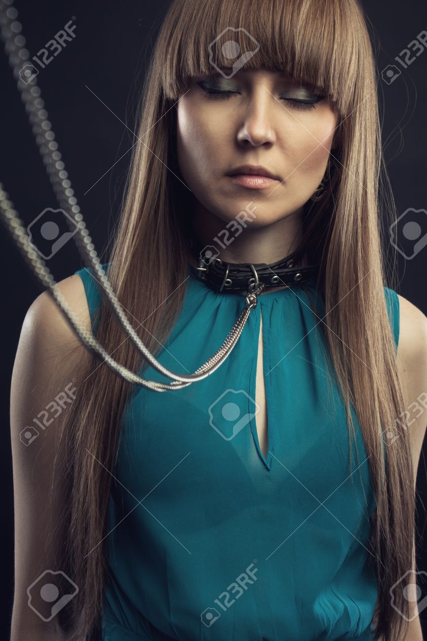 Cute attractive woman with leather collar Stock Photo - 19942074